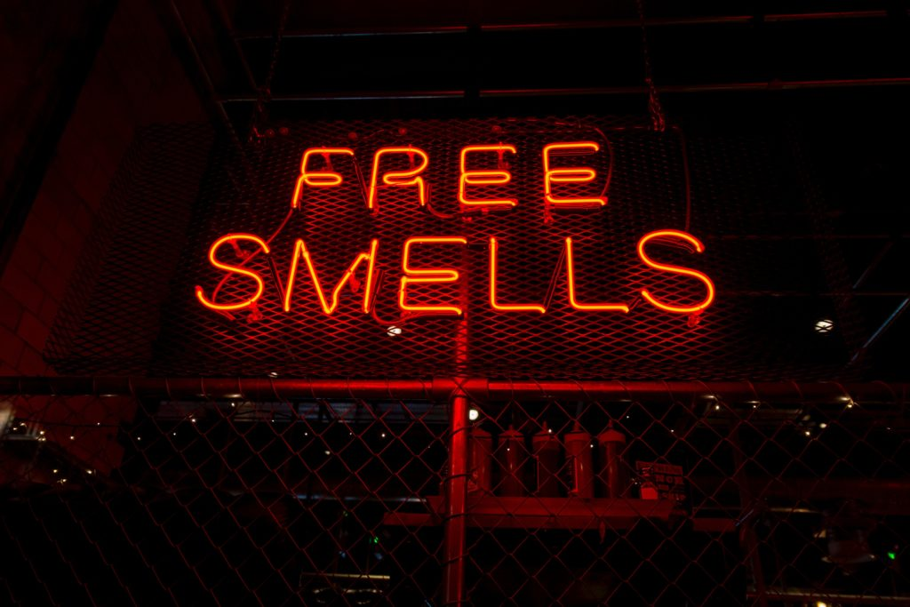 neon sign that says free smells